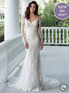 Sincerity Bridal 3936 // Featuring the tattoo lace trend, a fit-and-flare dress with cotton lace appliqués, lace Illusion sleeves and back. Jersey lining, hem lace and Godet train combine to create a stunning look.