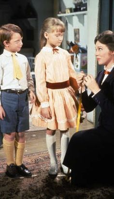 """Mary Poppins"" (Buena Vista, Mary Poppins (Julie Andrews) sees how Jane Banks and Michael Banks (Karen Dotrice and Matthew Garber) measure up. Mary Poppins Musical, Mary Poppins 1964, Julie Andrews Mary Poppins, My Fair Lady, Matthew Garber, Mary Poppins Halloween, Poppy Costume, Michael Banks, Films"