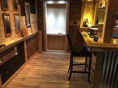 Oak floor getting installed, wine wall almost done, brick being installed, and hidden door/book case roughed in (Nov 10/ 2015)