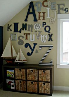 navy blue kids playroom letter wall
