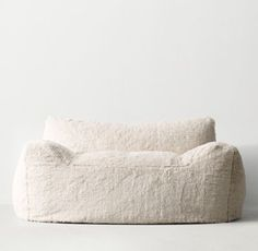 RH TEEN's Berlin Lounge Chair:The next-generation bean bag. Our collection's body-conforming foam-and-bead insert ensures classic sink-in comfort, while the raised back and arm rests add an element of support to its relaxed silhouette.