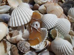 Brown beach glass pendant wrapped in by silversunstudiobiz on Etsy, $25.00