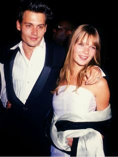 """Johnny Depp and Kate Moss during 'Don Juan De Marco' Beverly Hills Premiere at The Academy in Beverly Hills.  She's the """"most iconic model"""" of all time, and has graced the covers of more than 300 magazines over the course of her 25 year career."""
