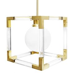 The Jacques Pendant is a little campaign style, a little bit nautical, and a lot of chic. A bold balance of masculine lines and feminine finishes composed of a solid lucite frame with custom-tooled polished brass corners. Hang one in your foyer or three overtop a kitchen island.    Details:  -Brushed brass and lucite chandelier  -Imported