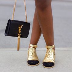 Photo taken by @liz_lizo on Instagram, black and gold Chanel brogues and YSL tassel bag.