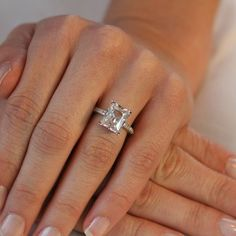 emerald cut diamond. Set with simple prongs on a diamond band