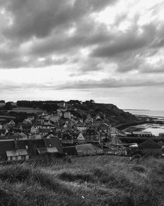The village of Port-en-Bressin  Low tide and low clouds. Taken from the cliffs above the village.  Summer 2015   Normandy #iphone5s #shotoniphone #lightroommobile #filmborn