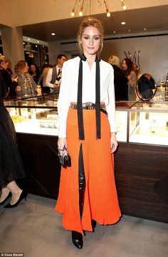 Olivia Palermo stands out in zesty orange thigh-split skirt - Celebrity Fashion Trends