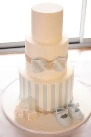 Bow tie baby shower cake idea with subtle blue, white and grey theme
