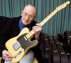 Les Paul holding a Fender Telecaster