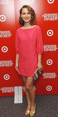 Natalie Portman in a pink silk Elizabeth & James minidress and gold heels