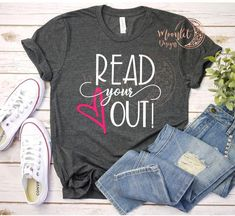 """""""Read Your Heart Out""""  What a great way to show your love of reading to your students! They make great Teacher Appreciation Gifts or end of the year gifts as well! Many color options available....All of my items are 100% customizable. Please message me with any special request, I am happy to help!...This is a unisex style crew neck tee with a relaxed fit. It is a soft heather style t-shirt with your choice of color (see pictures for color options). Made with high quality heat transfer vinyl…"""