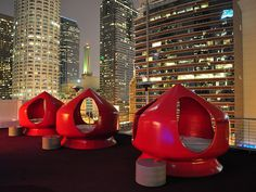 Downtown LA, Los Angeles, California, USA: Standard hotel rooftop on former Superior Oil company building; red waterbed pods