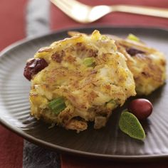 Serve these miniature crab cakes as a holiday appetizer or at brunch. Rubbed sage and orange zest season the crab cake mixture and dried cranberries add festive color.