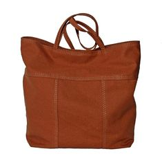 Made with water repellent canvas. Great all-weather bag. Handmade in New Orleans. Brown Leather Totes, Leather Bags Handmade, Everyday Bag, Tote Purse, Pouch, Wallet, Cotton Canvas, Random Items, Tablet Phone