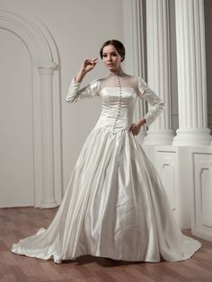 Long Sleeved High Neck Buttoned Satin and Tulle Wedding Dress Brands:Luxe EliseFreeship:YESFabric:Satin/TulleFabric(main):WeddingTailoring Time (Standard):15-20 DaysTailoring Time (Rush Order):10-15 DaysSilhouette:Ball GownNeckline:High-neckSleeve…