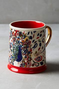 Mooreland Mug: Peacock mug- I LOVE this dish set! This is just the mug but it features the peacock so beautifully. If you're interested, look them up on anthropologie.com