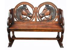 Hand carved, mahogany horse head bench from Pike Road Pillow Company.
