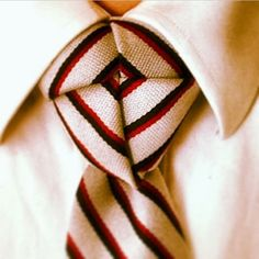 That is what a perfect Truelove necktie knot looks like if you take the time to make the stripes work for you!
