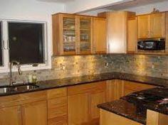 Image result for golden oak cabinets with quartz