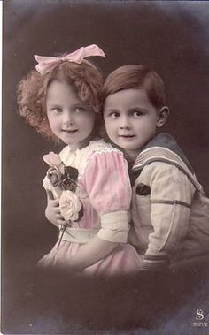vintage portrait of little girl and her brother  pink, blue, white, pink bow, colored sepia
