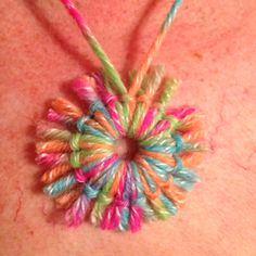Washer necklace with yarn - neat! I think we'll use yellow yarn and make the sun.