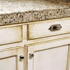 grayish glazed and distressed cabinets, granite-tile countertop to save on cost of full granite slab