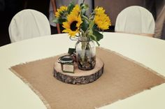I LOVE THE WOOD SLICE IN THE CENTERPIECE WITH THE BURLAP BUT I WANT MORE BURLAP WITH LACE ON THE TABLES THAN THIS!