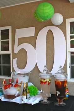 50th Birthday Party Ideas -- Create a classy drink table featuring the birthday boy or girl's age #50thbirthdayparty #birthdayideas #adultbirthday