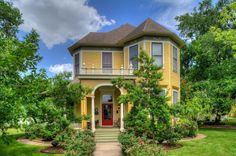 Built in 1898, this 4-bedroom Navasota home has original woodwork and wrap-around porch and is a historical landmark.