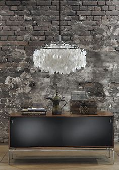 Industrial Glam ~ love the juxtapositions of the brick wall and the elegant chandelier - splendid sass!