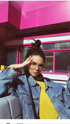 Kendall Jenner's Spring Street Style Denim Jacket With Bright Yellow Jumper And Retro Shades