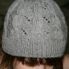 Hermione Cable & Eyelet Hat, knitting pattern based on Harry Potter and the Deathly Hallows by JL Yarnworks.  This is my very favorite hat to knit - in all colors, yarns, and sizes! I might try it next time with the slipknot cast on.