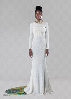 """To Dye For"", Resort Collection 2013 by ready-to-wear brand from Ghana, Christie Brown. A beautiful white gown with a colored train."