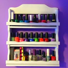 DIY Nail Polish Holder! My mom found an old spice rack at a garage sale and she had the amazing idea of spray painting it white and using it to display my nail polish collection! It looks so cute against my lavender walls. I have it hanging right above my jewelry rack.