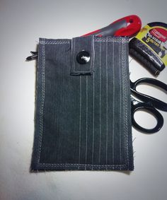 Upcycled denim man-ly Kindle pocket, lined with navy felt