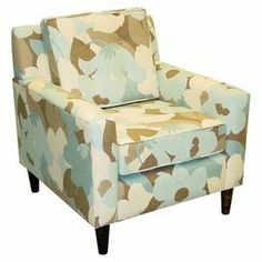 """Pine-framed arm chair with an oversized floral motif and foam cushioning. Handmade in the USA.  Product: ChairConstruction Material: Pine wood and fabricColor: MultiFeatures: Made in the USADimensions: 35"""" H x 31.5"""" W x 32"""" DCleaning and Care: Spot clean only"""