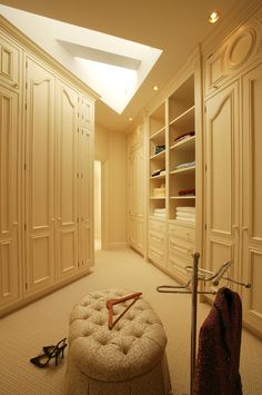 luxurious traditional walk in closet in warm tone and skylight addition chair slipcover unique hooker for jacket or coat of Dozens of Walk In Closet Organizers Lowes