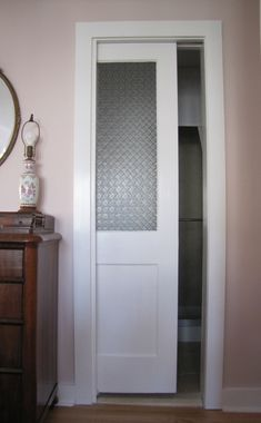 pocket door with glass, would love to switch out the bathroom door for a pocket door