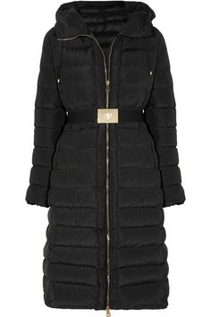 Moncler's long-line 'Imin' coat is cut from black shell and insulated with the French label's ultra lightweight down. This quilted design is fitted with a handy adjustable drawstring hood and zipped pockets. Define your waist with the elasticated belt.