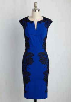 You're celebrating a successful year at your upstate lodge, and you look as gorgeous as the decorations on this cobalt dress! Crocheted black lace adorns the form-fitting silhouette of this cap-sleeved sheath, swirling with elegance like the venue's sparkling lights.