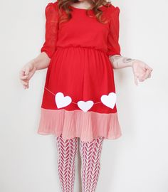 pretty adorable valentines maternity shot. I like the tights