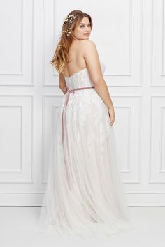 This strapless wedding gown features a sweetheart neckline and A-line silhouette with whimsical uncorded alencon lace elegantly trickling down into the skirt. A velvet ribbon sash completes the look. Plus Size Wedding Gowns, Velvet Ribbon, Geraniums, Designer Dresses, Feminine, Bride, Formal Dresses, Lace, Whimsical