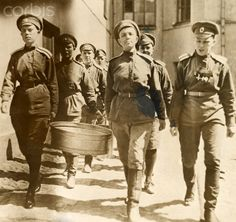 Members of the WWI Russian women's Battalion of Death carry pots. - 42-32919502 - Rights Managed - Stock Photo - Corbis