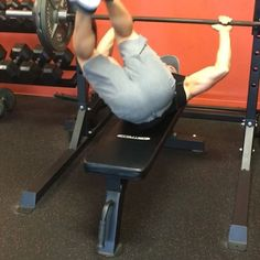 Simole@ab exercise you can try. It's all about touching right hip and left while lower back is off bench and holding on the bar lightly.  Perform 4 sets x 15-25 reps. Each rep = roll center, right hip, left hip.  Make sure your legs don't touch your chest and abs are engaged entire time..then go workout