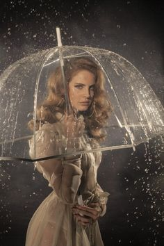 Lana del rey is a good indie alternative musical figure and holds the right look i want for my front cover Lana Del Ray, Lana Rey, Clear Umbrella, Under My Umbrella, Transparent Umbrella, Bubble Umbrella, Umbrella Girl, Rain Umbrella, Trip Hop