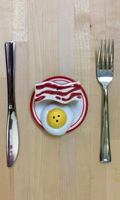 The perfect novelty salt and pepper shakers for breakfast lovers are shaped like a slice of bacon and a sunny-side-up egg