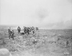 Troops advancing under a German barrage east of Arras, 1918