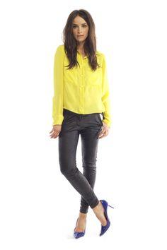 Neon Heidi Merrick button-down with black pants & blue pumps.