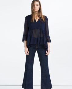 Image 1 of SHIMMER THREAD BLOUSE from Zara